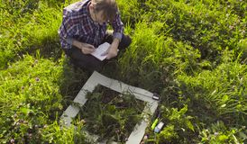 Free The Man Ecologist Making Notes In The Diary Stock Image - 128871631