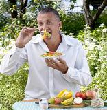The Man The Vegetarian Tastes Salad Stock Images