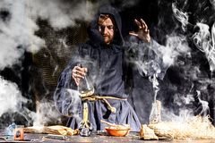 Free The Medieval Alchemist Make Magic Ritual At The Table In His Smoke Laboratory Stock Photography - 156700752