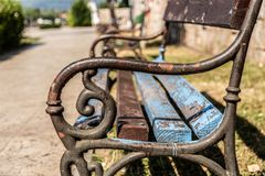 Free The Metal Rusted The Handle On The Wooden Bench In The Park Royalty Free Stock Images - 154084629