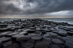 Free The Natural Hexagonal Stones At The Coast Called Giant`s Causeway, A Landmark In Northern Ireland With Dramatic Cloudy Sky Royalty Free Stock Image - 163252596