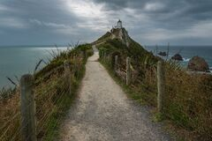 Free The Nugget Point Lighthouse On A Moody And Cloudy Afternoon Royalty Free Stock Photos - 177668768