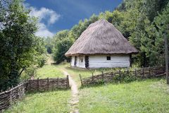 Free The Old Village Hut With Thatched Roof Fenced With A Fence Of Vines Royalty Free Stock Photos - 121979198