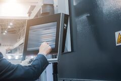 Free The Operator Presses Buttons On The Terminal For Industrial Sheet Metal Processing Equipment Royalty Free Stock Photos - 187486038
