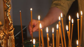 Free The Parishioner Put A Candle Inside An Orthodox Church Royalty Free Stock Image - 98353776