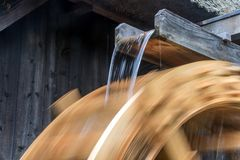 The Part Of Mill Wheel Rotates Under A Stream Of Water, Royalty Free Stock Images