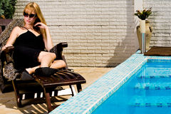 The Pool And My Black Dress Stock Photo
