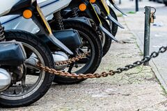 Free The Rear Wheels Of The Pizza Delivery Scooter Chain Are Locked With An Anti-theft Chain Stock Photos - 169674903