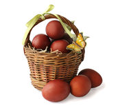 The Red Colored Eggs And A Butterfly In A Basket Stock Photos