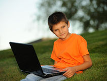 The Schoolboy With A Laptop Stock Photos