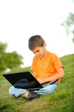 The Schoolboy With A Laptop Stock Photography