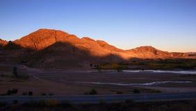 The Setting Sun Shone On The Mountains Stock Photo