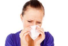 The Sick Girl Sneezes Stock Photo