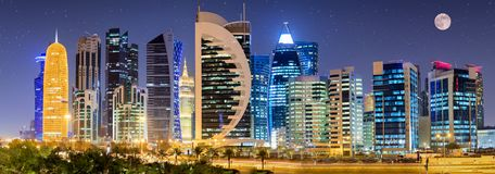 The Skyline Of Doha With Full Moon And Stars