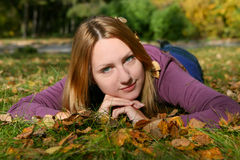 The Smiling Girl Lays On A Grass Royalty Free Stock Images