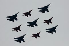 Free The Swifts And Russian Knights Pilots On The Su-30 SM And MiG-29 Planes Fly Over Red Square During The Parade On Victory Day In Wo Stock Photography - 182978962