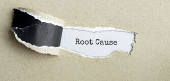 Free The Text Root Cause Appearing Behind Torn Brown Paper Stock Photo - 192987040
