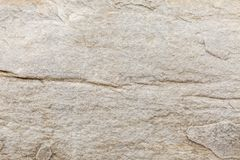 Free The Texture Of The Surface Of Natural Stone, Close-up. Building Material Of Ancient Civilizations. Background. Spaces For Text Royalty Free Stock Photography - 154465877