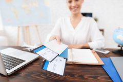 The Travel Agent Keeps Tickets For The Plane In The Travel Agency. Royalty Free Stock Photography