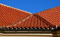 Free The Trough Of Two Roofs Bent Into A Turn With Italian Folded Tiles And A Metal Gutter. You Can See The Ridge Of The Roof With Conc Royalty Free Stock Photos - 209289148