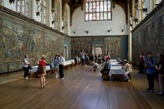 Free The Tudor Great Hall With Group Of Tourists Admiring The Paintings And Artworks. Royalty Free Stock Photography - 153422477