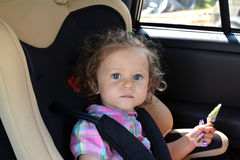 Free The Two-year-old Girl Sits In The Car In A Baby Car Seat Royalty Free Stock Images - 73282619