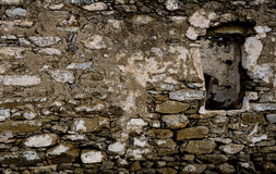The Wall Of The Old Rough Stone With A Window Royalty Free Stock Photography