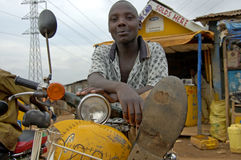 Free The Way People Life In Uganda. Boy Relaxing On His Scooter. Stock Image - 87977371