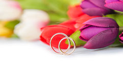 The Wedding Rings And Flowers On White Background Royalty Free Stock Photos
