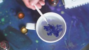 Free The White Glass With Clear Water Dunk A Brush With Blue Paint. Royalty Free Stock Photography - 77484597