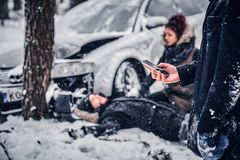 Free The Witness Of The Accident Keeps The Phone And Is Going To Call The Rescue Service. Royalty Free Stock Images - 139013719