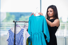 Free The Woman Choosing Clothing In Shop Stock Photos - 74571653