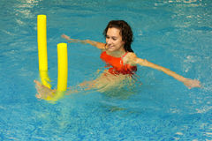 The Woman Does Exercise In Water Stock Images