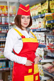 The Woman Seller In Food Supermarket Royalty Free Stock Images