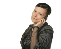 The Woman Talks By A Mobile Phone Royalty Free Stock Photos