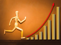 Free The Wooden Figure Running On Stairs Of Business Plan Royalty Free Stock Photography - 77066927