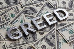 Free The Word GREED Laid With Aluminium Letters On The US Dollar Banknotes Background - With Selective Focus Royalty Free Stock Image - 161391046