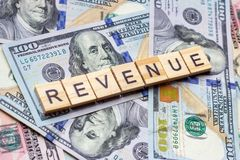 Free The Word Revenue On Dollar Usa Background. Profit And Business Growth Concept. Stock Photos - 155430243