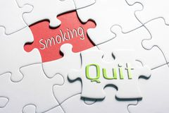 Free The Words Quit And Smoking In Missing Piece Jigsaw Puzzle Royalty Free Stock Photo - 128908095