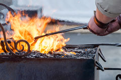 Free The Work Of A Blacksmith With Metal By The Fire Stock Photos - 68462313