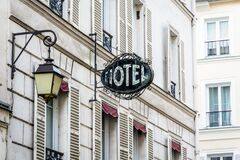 Free The Worn Period Sign Of An Hotel And A Vintage Street Light Fixed To An Old Building In Paris Royalty Free Stock Photography - 181804257