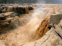 Free The Yellow River Hukou Waterfall Scenic Area, Hukou Waterfall, Known As The `Yellow River Wonders`, Is The Only Yellow Waterfall O Stock Photo - 161247820