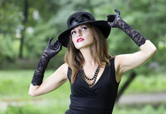 The Young Beautiful Woman In A Hat Royalty Free Stock Photos