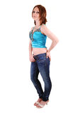The Young Girl In Jeans And Blue Top. Stock Photo