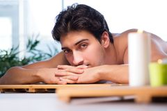 Free The Young Handsome Man During Spa Procedure Royalty Free Stock Image - 113320956