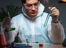 Free The Young Male Lab Chemist Late At Night In Overtime Time Stock Images - 160876724
