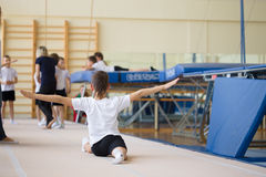 Free The Young Man Performs Gymnastic Exercises In The Gymnasium. Stock Images - 92017904