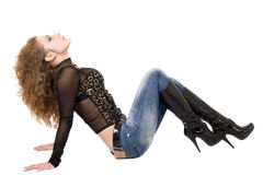 The Young Woman In Blue Jeans And Black Boots Stock Image