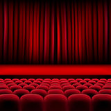 Theater auditorium with rows of seats and stage with curtain Stock Photo