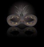 Theater or Carnival mask with reflection on black background Royalty Free Stock Photo